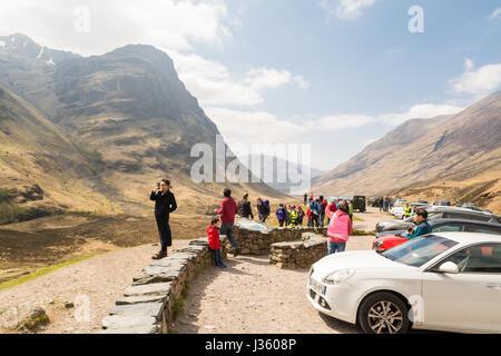 Glencoe, Scotland - tourists at the Three Sisters viewpoint, Scottish HIghlands - Stock Photo