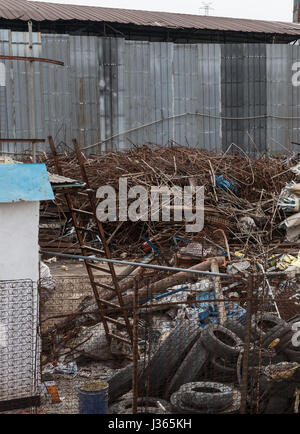 dumpsite with lots of rubbish - Stock Photo