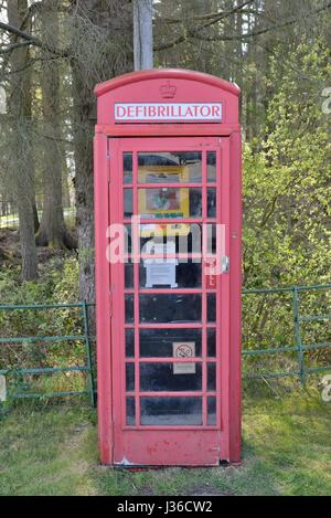 An old BT telephone box now housing an emergency defibrillator for public use in a remote location in Scotland, - Stock Photo