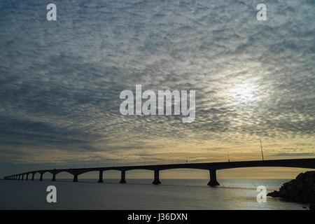 Cloudy skies over the Confederation Bridge linking Prince Edward Island with mainland New Brunswick, Canada.