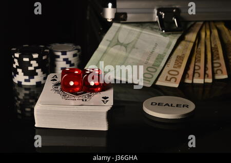 Cassino concept, euro money, chips and red dices on the table - Stock Photo