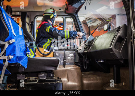 Firefighter drives a emergency vehicle with communication interior view - HDR - Stock Photo