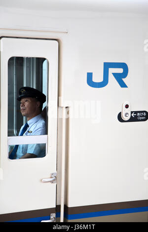 KYOTO, JAPAN - OCTOBER 8, 2016: Unidentified man in train of Japan Railways Group. This group maintains a Japanese - Stock Photo