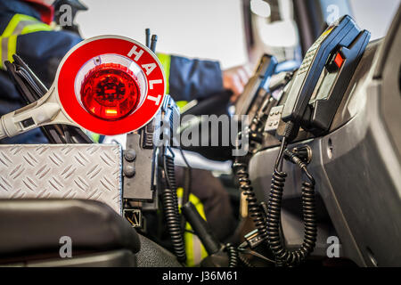 Firefighter drives a emergency vehicle with communication interior view and trowel - HDR - Stock Photo