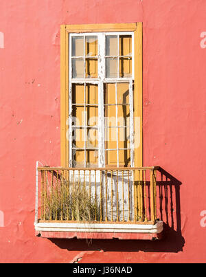 Grass and weeds growing on balcony of derelict building in Spain - Stock Photo