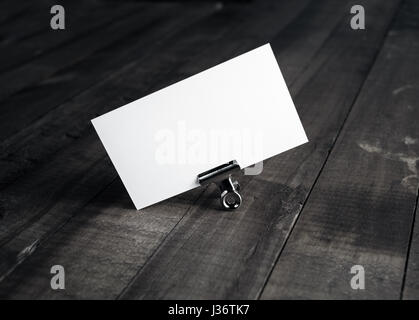 Photo of blank white bussiness card on wood background. Mockup for ID. Template for promotion of corporate identity. - Stock Photo