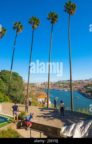 Porto Porto park, tourists photograph the panoramic view of the Douro river from the Jardins do Palacio de Cristal - Stock Photo