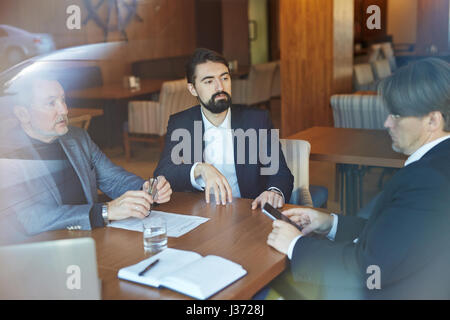 Bearded Entrepreneurs Conducting Negotiations - Stock Photo