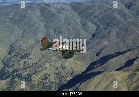 A very rare Russian fighterplane from WW II, Polikarpov I-16 Rata, flying over The Southern Alps in New Zealand - Stock Photo