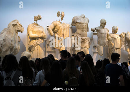 'The Gods look down', Tourists viewing sculptures from The East pediment of the Temple of Zeus. Archaeological  - Stock Photo