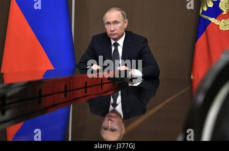 Russian President Vladimir Putin during a video conference to discuss wildfires in Siberian from his Black Sea residence - Stock Photo