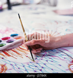 Woman's hand painting. - Stock Photo
