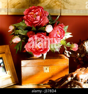 Flowers on wooden box. - Stock Photo