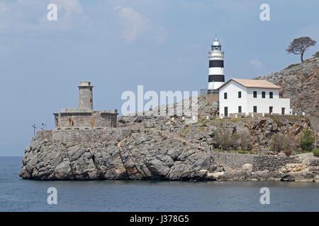 harbour entrance with lighthouse of Port de Sóller, Mallorca, Spain - Stock Photo