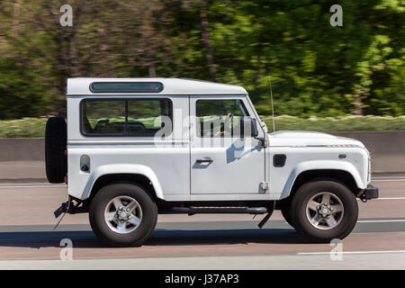 Frankfurt, Germany - March 30, 2017: Land Rover Defender 90 driving on the highway in Germany - Stock Photo