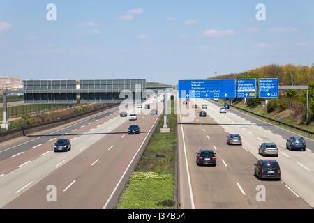 Frankfurt, Germany - March 30, 2017: Traffic on the autobahn A5 - highway number 5 - near the city of Frankfurt - Stock Photo