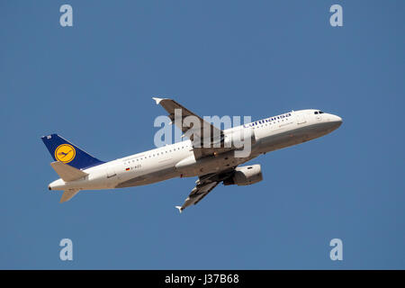 Frankfurt, Germany - March 30, 2017: Lufthansa airlines Airbus A320-200 after take off at the Frankfurt international - Stock Photo