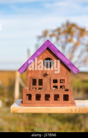 Close up of tiny and colorful wood house. Illustration for Real Estate or Construction. - Stock Photo