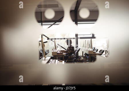 Male audio engineer working on digital editing screen in recording studio - Stock Photo