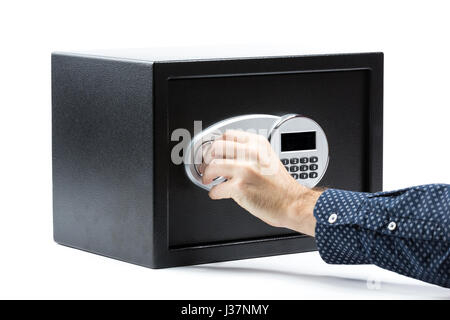 Man hand opened a safe deposit box on a white background - Stock Photo