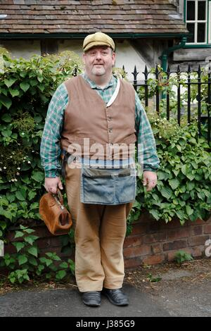 Tradesman in traditional costume at Blists Hill Victorian Museum. Ironbridge, Shropshire, UK - Stock Photo
