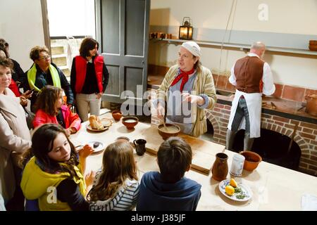Chefs in traditional dress demonstrate cookery at the Royal Kitchens, Kew Gardens, London, UK - Stock Photo