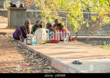 Documentary editorial image. Pondicherry, Tamil Nadu, India - April 24 2014. Very poor families people in the street, talking. Poverty Stock Photo