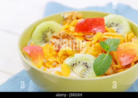 bowl of corn flakes with milk and fresh fruit - close up - Stock Photo