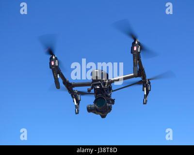 DJI Inspire 1 Pro Black edition drone in flight - Stock Photo