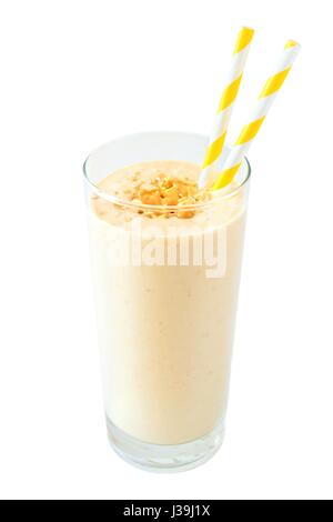 Peanut butter banana oat breakfast smoothie with paper straws isolated on a white background