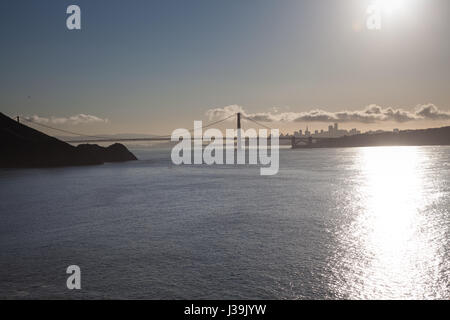 View of the San Francisco City Line over the Golden Gate Bridge - Stock Photo