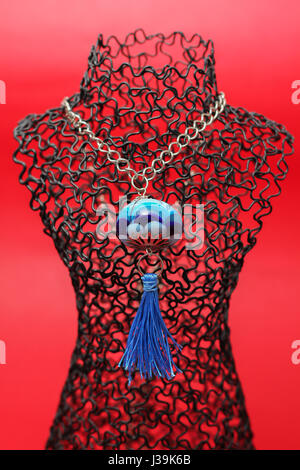 handmade women blue necklace from glass - Stock Photo