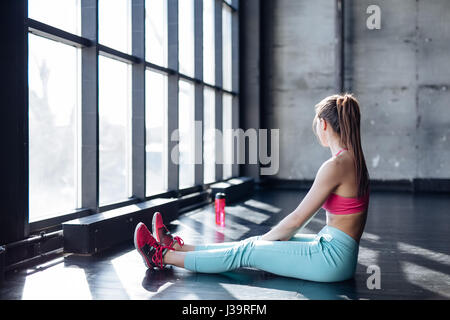 fitness athlete woman drinking water after training work out exercising - Stock Photo