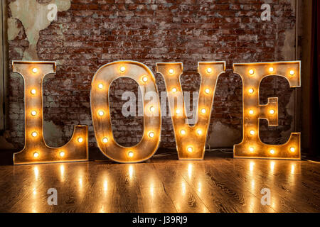 Love sign luminous - Stock Photo