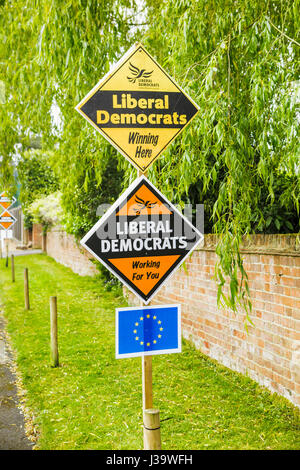 Roadside orange diamond-shaped boards, placards or signs on grass verge supporting and electioneering for the Liberal - Stock Photo