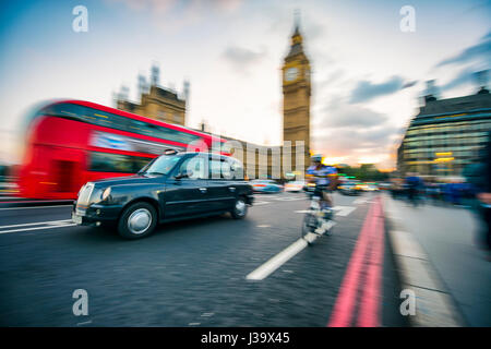 LONDON - OCTOBER 4, 2016: Traffic passes in motion blur on Westminster Bridge, a busy crossing that passes next - Stock Photo