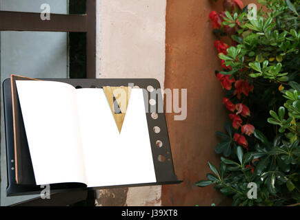 Open guests book on a lectern - Stock Photo