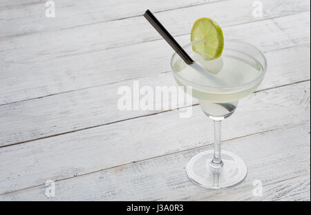 margarita cocktail with lime on white woodenbackground - Stock Photo