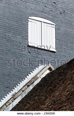 Hayloft door above a roof in Poole, Dorset, England - Stock Photo
