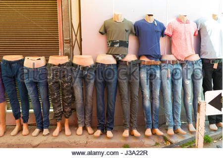 Dummy legs displaying jeans on a traditional street market stall in the Turkish quarter of Nicosia, Cyprus - Stock Photo