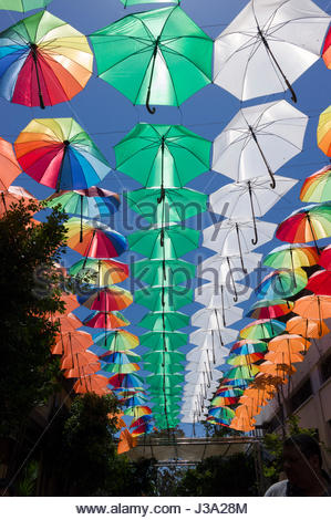 A 'Ceiling' of coloured umbrellas forming a display above an outside cafe in the Turkish quarter,Nicosia, Cyprus - Stock Photo