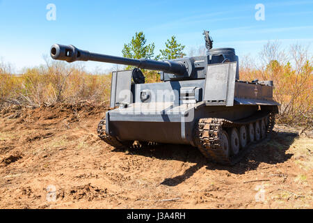 Samara, Russia - April 30, 2017: Reconstructed vintage German Tiger tank on the battle field in summer sunny day - Stock Photo