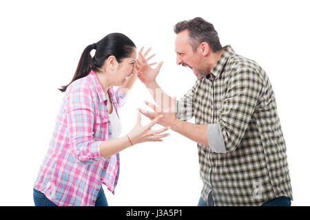 Young couple having an argue and yelling at each other isolated on white background - Stock Photo