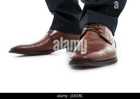 Close-up of leather elegant man shoes standing still isolated on white background - Stock Photo