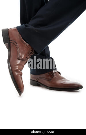 Close-up of side view leather brown elegant man shoes posing relaxed isolated on white background - Stock Photo