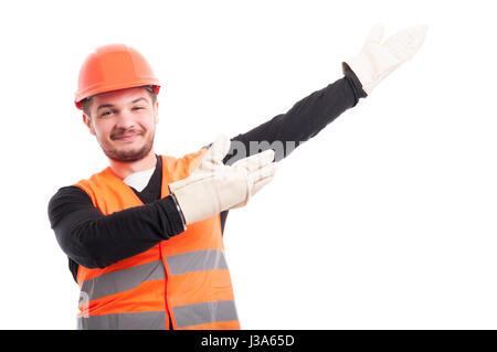 Architect with helmet showing something upwards isolated on white studio background - Stock Photo