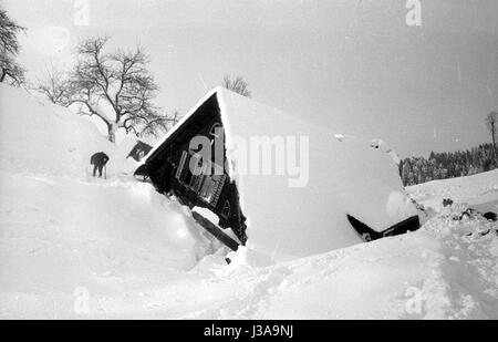 Buried houses after the avalanches in Blons, 1954 - Stock Photo