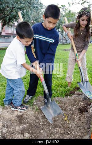 Miami Beach Florida Flamingo Park Captain Planet's Carnival Earth Arbor Day family event tree planting Hispanic - Stock Photo