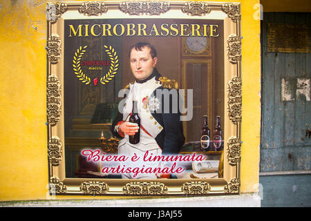 A micro-brewery adjacent Maison Bonaparte (Napoleon's ancestral home) features a poster of the self-proclaimed Emperor - Stock Photo