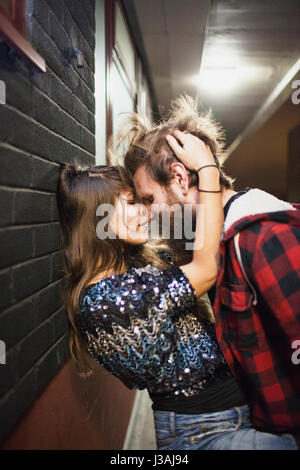 Young couple embracing on a balcony - Stock Photo